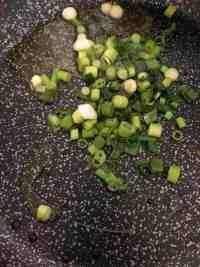 Spring Onions in oil in frying pan