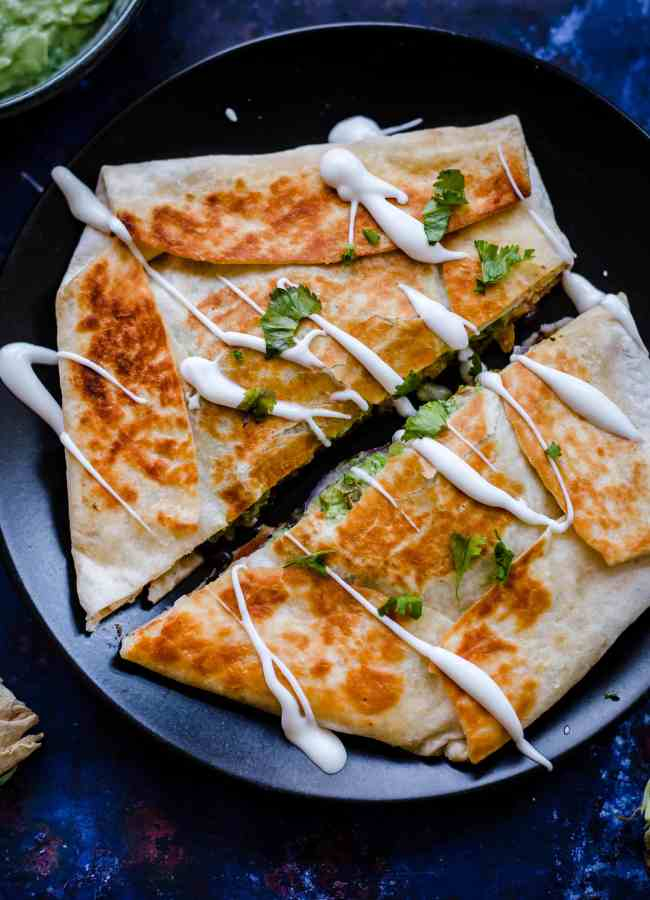 Crunch Wrap on plate, drizzled with sour cream