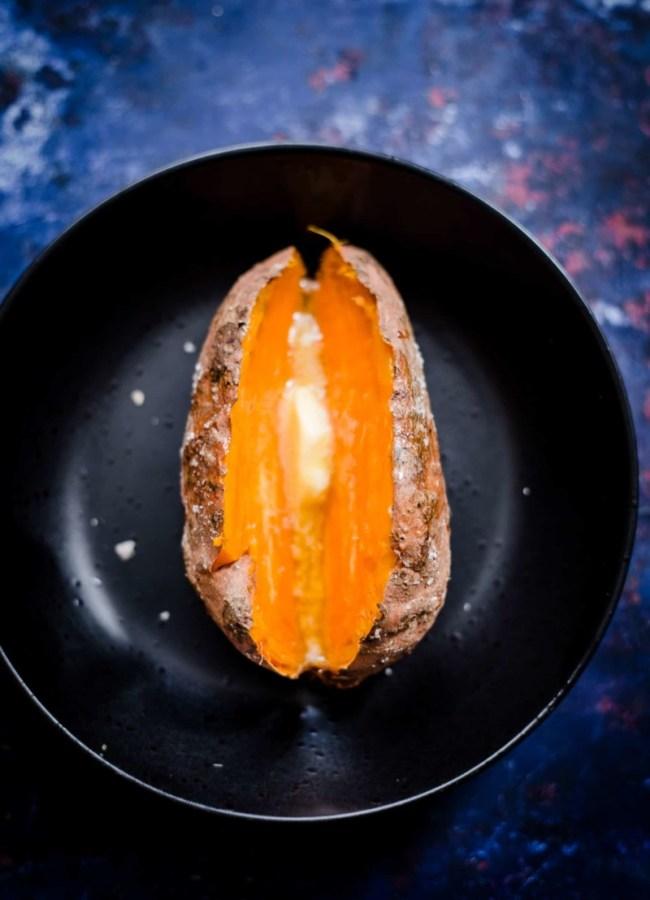 Sweet potato split open with butter