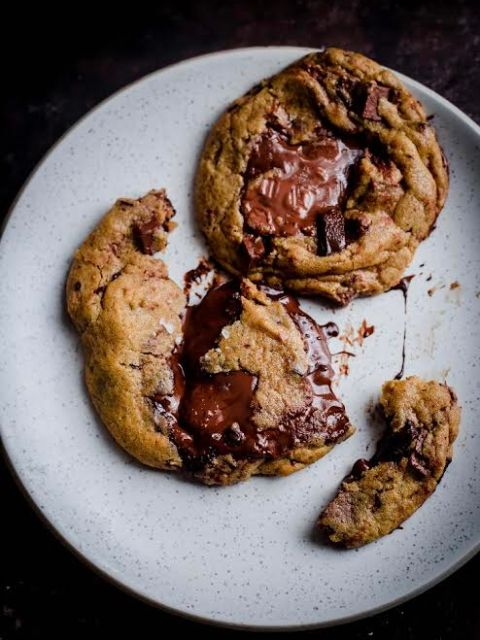 2 Nutella Cookies on plate, one open to show inside