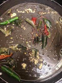 Chillies, Curry leaves, Mustard seeds in pot