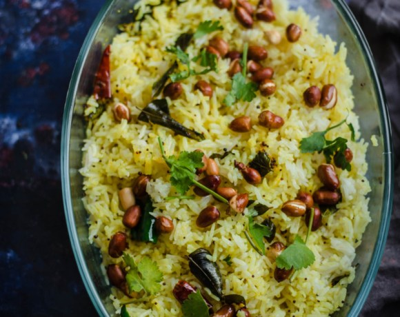 Lemon Rice in dish topped with fried peanuts and coriander
