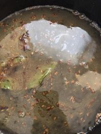 Water added to pot with spices