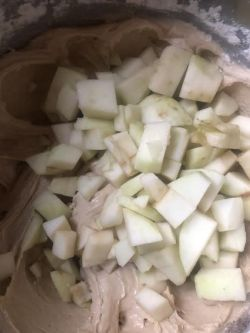 Apples being folded into batter