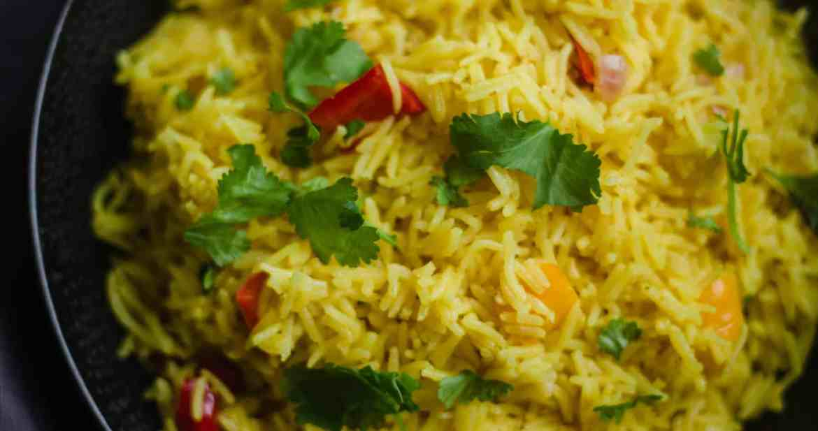 Peri rice in a bowl sprinkled with Coriander
