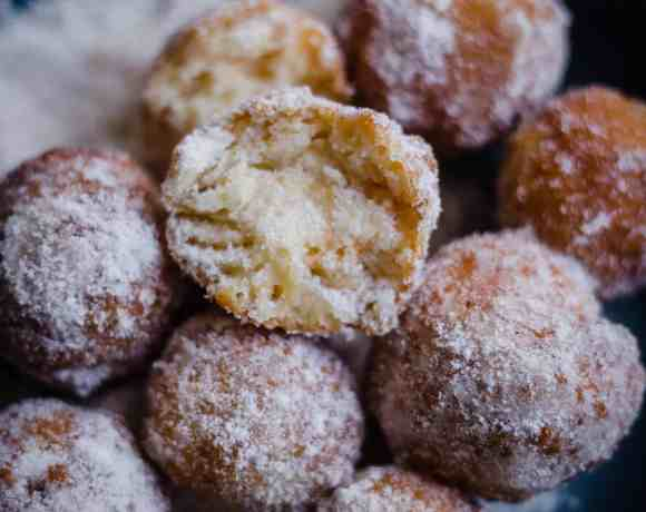 Donuts with cinnamon sugar in bowl