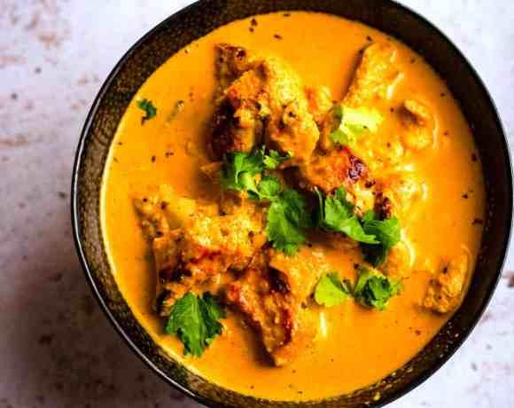 Butter Chicken in a bowl with Coriander as garnish