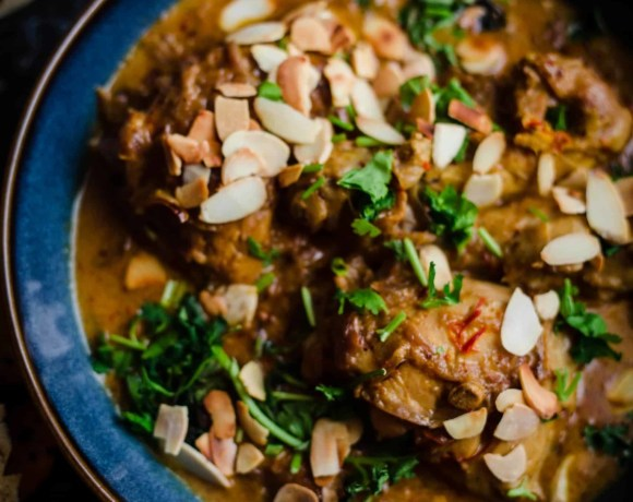 Chicken Chaap in bowl with flaked almonds on top