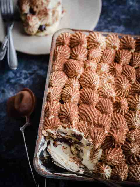 Nutella Tiramisu in a dish with one portion in a plate