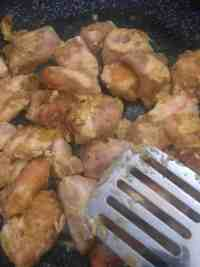 Chicken being fried in a pan
