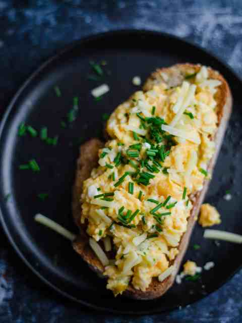 Scrambled Eggs with Cheese and chives on a piece of toast