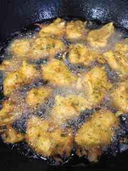 Aloo Pakora frying in oil