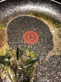 Curry leaves and Mustard Seeds in oil and ghee