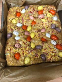 par cooke blondies with sprinkles and mini eggs on top