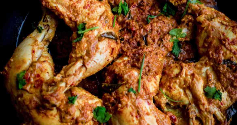 Chicken Ghee Roast in a black bowl