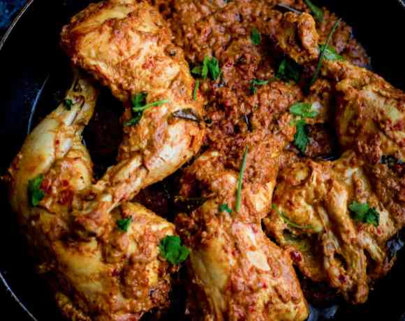 Chicken Ghee Roast in a black bowl