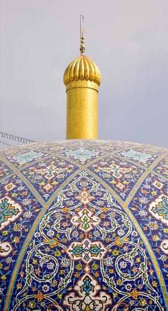 Patterned dome and gold minaret