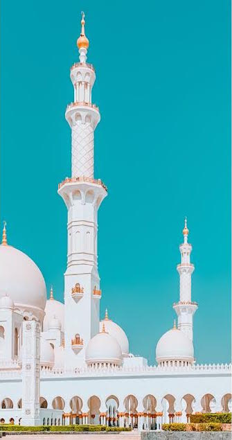 White mosque against blue sky