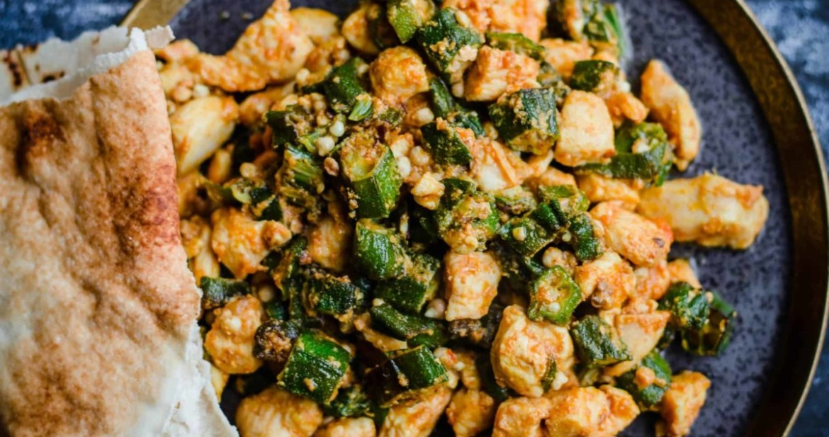 Bhindi Chicken in a grey plate with naan to side