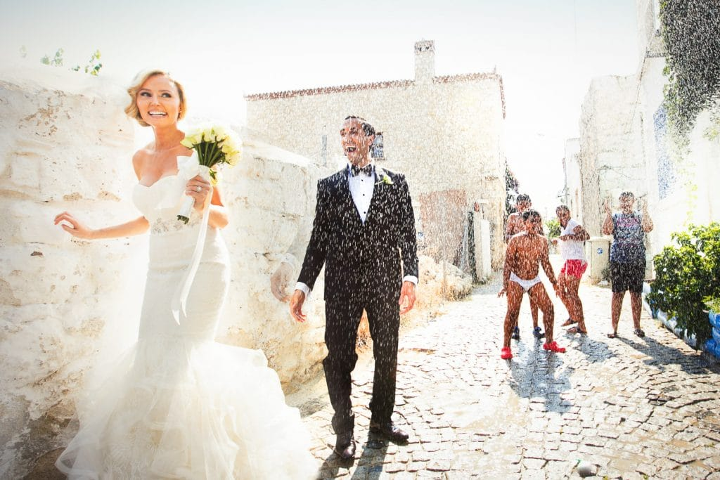 Create Client Experiences: Bride & Groom Walking Down Cobblestone Alley