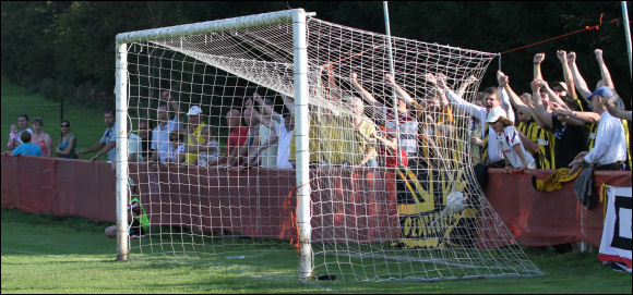 City's fans celebrate as Will Morford's shot hits the back of the net