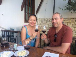 Tiggerbird cheers Cobo winery Berat with cheese and wine