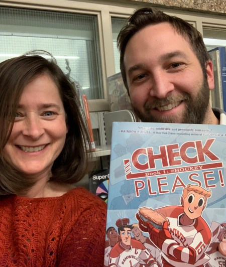 "Jeanie Phillips (l) and Peter Langella, along with ""Check Please! Book 1: #Hockey"""