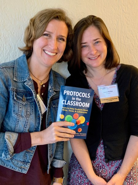 Author Terra Lynch (left) and host Jeanie Phillips (right) hold up a copy of the book Protocols in the Classroom