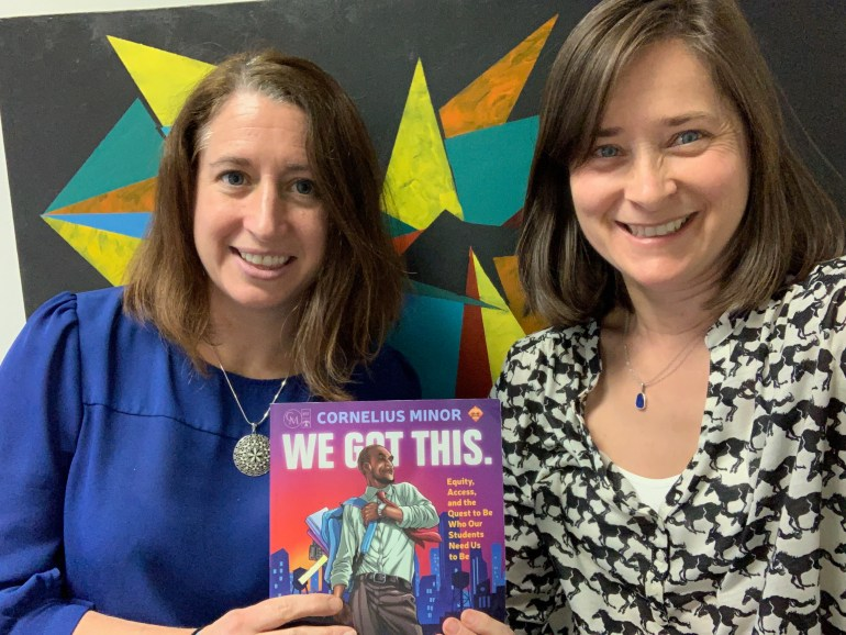 """Kathleen Brinegar (left) and Jeanie Phillips (right) with a copy of """"We Got This"""", by Cornelius Minor"""