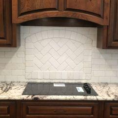 Travertine Kitchen Backsplash Curtain For Window White N Koehn Tile El Campo Tx Framed Accent Behind Cooktop With Herringbone Pattern