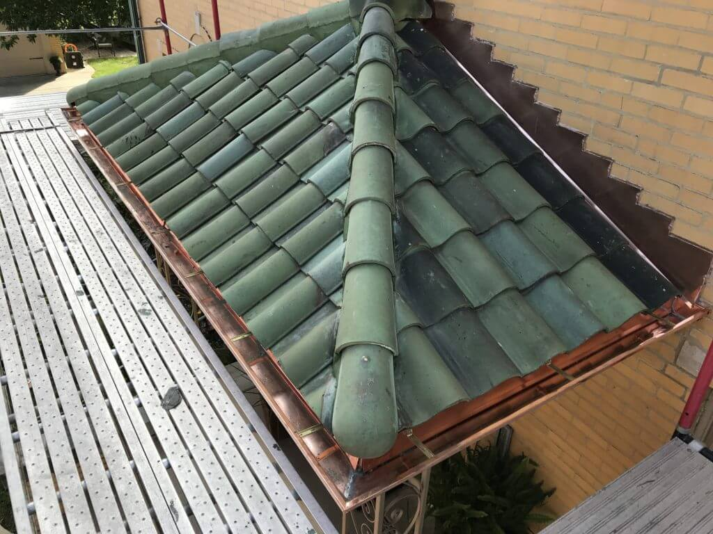 tile and copper roof on front porch