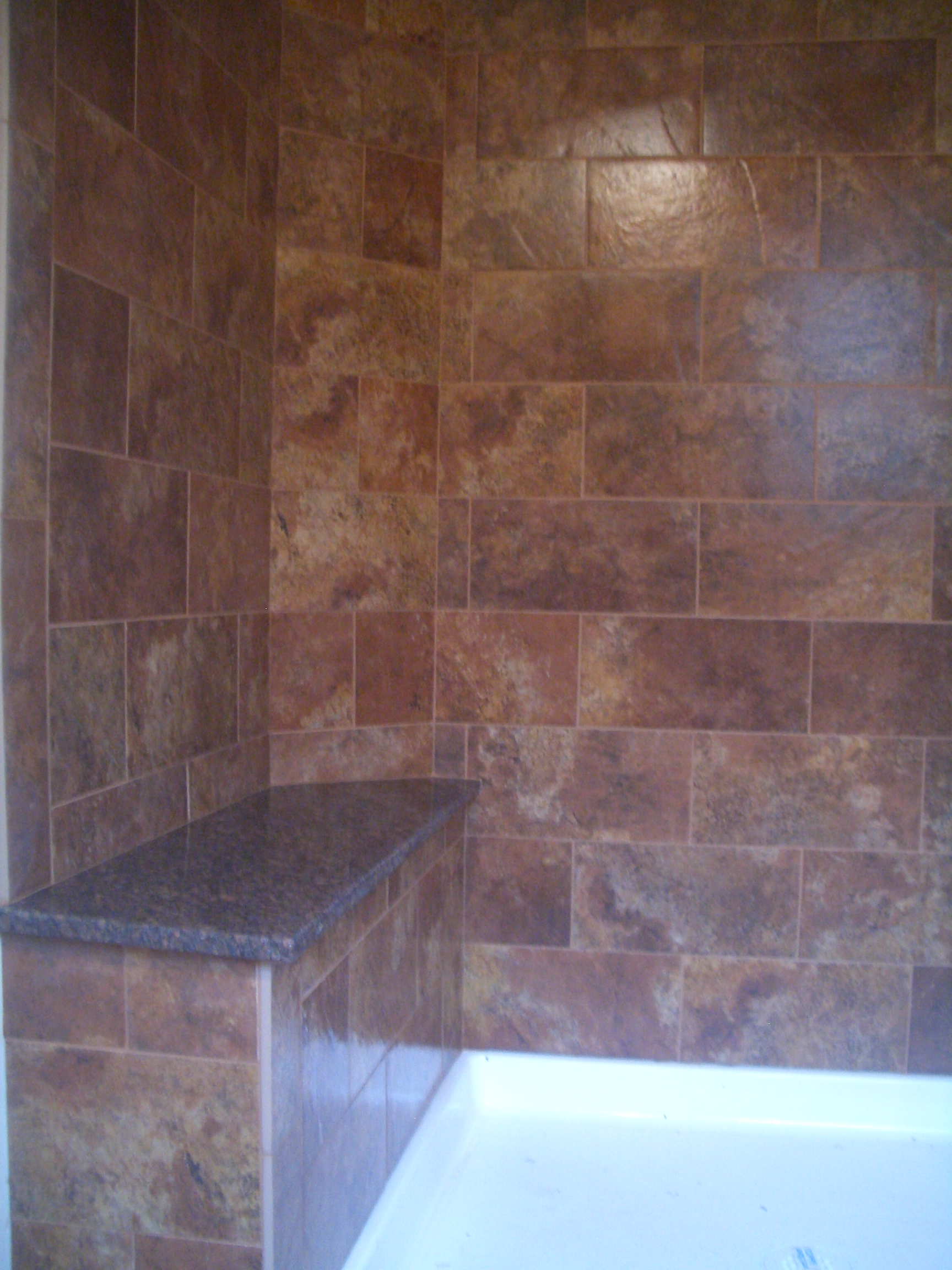 Colorado Red Granite : Subway style shower in red feather lakes