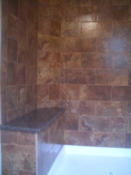 Porcelain subway tile shower with granite bench in Red Feather Lakes, Colorado