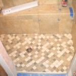 Kerdi shower floor with brushed nickel Kerdi drain