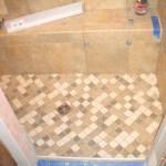 Kerdi shower floor with brushed nickel Kerdi drain
