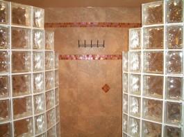 Towel rack with heating element behind tile