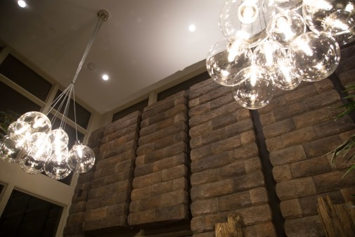 Interior installation of stone wall and energy-efficient lighting.