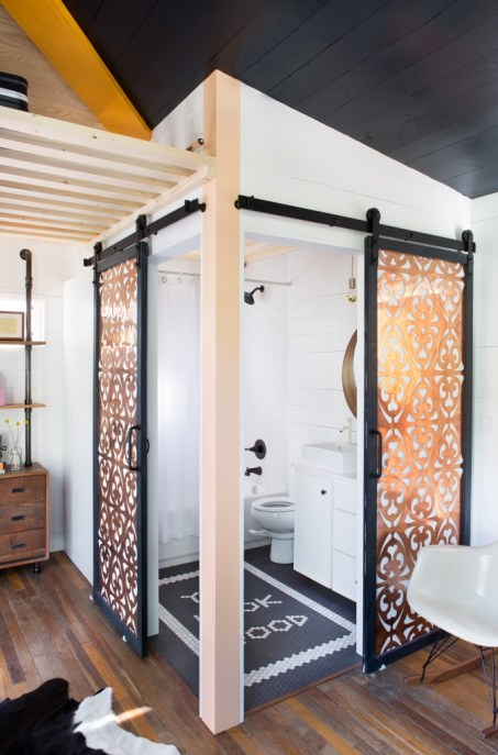 Check out that mosaic tile work on the shower floor! FYI Tiny House Nation. Photo credit: Molly Winters Photography.