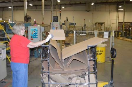 Dal-Tile employees utilize the company's recycling collection bin in a continuous effort on maintaining a Zero Landfill commitment.