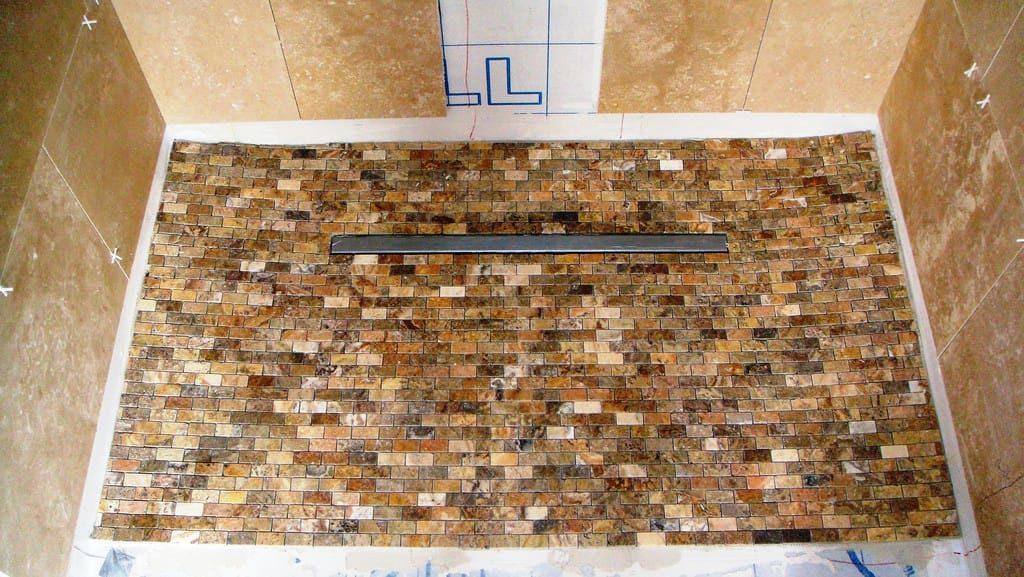 linear shower drains vs center shower