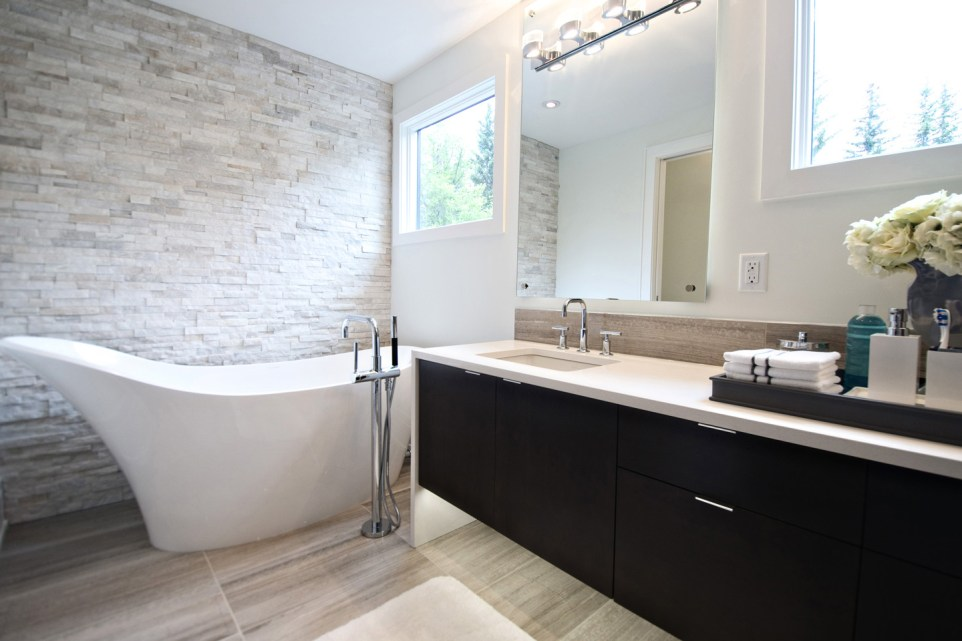 Alaska White Ledgestone installed behind a freestanding tub in a bathroom