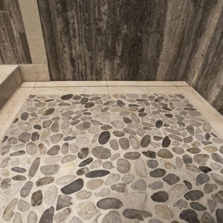 Kootenay Pebbles & Baja White installed in a shower base
