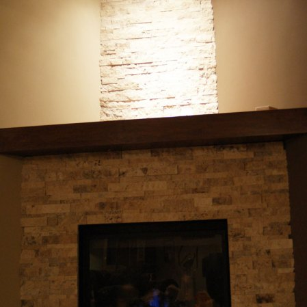 Picasso travertine ledgestone installed on a fireplace