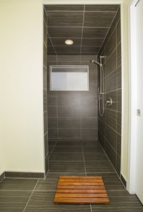 Twine Dark Porcelain Tile Installed in a shower