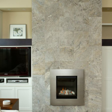 Silver Travertine Tile installed on a fireplace