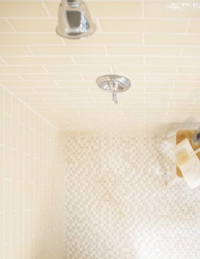 Jeffrey Court Natural Burlap Field Tile and Organic Composition Mosaic installed in a shower