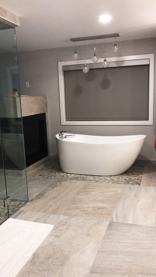 Silver Travertine and Kootenay Flat Pebbles installed in a bathroom
