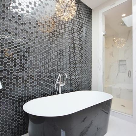 Stardust Black Hexagon and Marble Imitation Calcutta porcelain tile installed in a bathroom