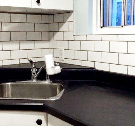 Soho White 3x6 installed on a backsplash