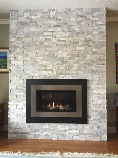 Silver Cubic Travertine Ledgestone installed on a fireplace